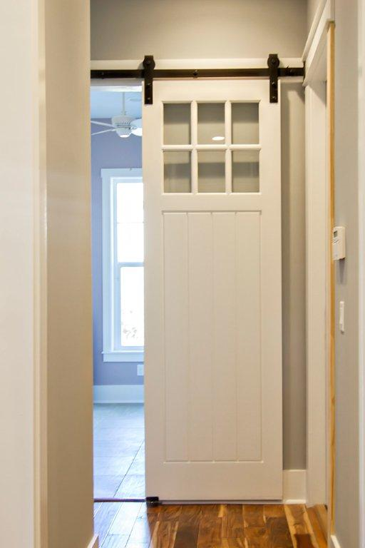 gallery door sliding office with from separates the homes bathroom view in for home barn doors southland building small offices