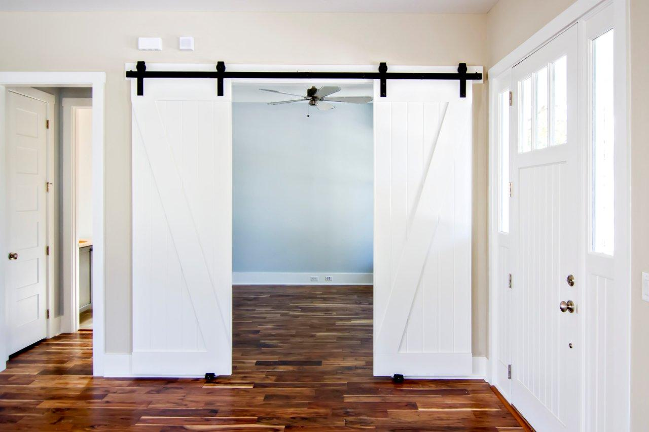 Uses for sliding barn doors in your new home in for Sliding entry doors